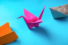 foto of float-plane  - crop close-up of colored paper origami plane crane, boat