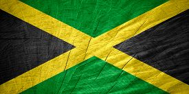 image of jamaican flag  - Jamaica flag or Jamaican banner on wooden texture - JPG