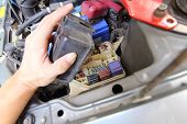 pic of fuse-box  - hand of the man open the fuse car box - JPG