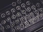stock photo of typewriter  - Vintage Typewriter close up on Letter button - JPG
