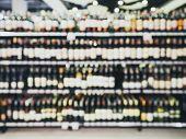 picture of liquor bottle  - Blurred Wine Liquor Bottle On Shelf Bar shop retail - JPG