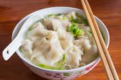 picture of wanton  - Chinese tasty wonton and noodle soup on white background - JPG