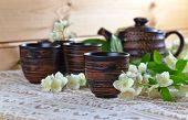 picture of teapot  - Teapot with small cups and jasmine flowers - JPG