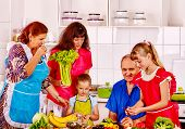 stock photo of grandfather  - Happy family with child cooking at kitchen - JPG