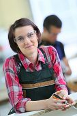 stock photo of carpentry  - Portrait of young woman in carpentry school  - JPG