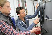 picture of temperature  - Young man in professional training measuring heat pump temperature - JPG