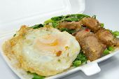 picture of crispy rice  - Thai popular menu for packed lunch Kana Moo Grob Khai Dao - JPG