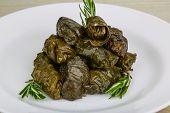 foto of grape leaf  - Greek dolma in grape leaves with meat served rosemary - JPG