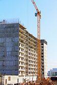 image of construction crane  - Building construction site with big crane against of blue sky - JPG