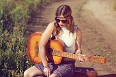 picture of hippy  - Beautiful hippie girl with a guitar in the countryside - JPG