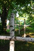 stock photo of anonymous  - anonymous wooden crosses on an old cemetery - JPG