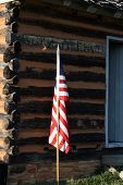 American Flag and Rustic Cabin