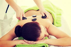 pic of stone-therapy  - Girl on a stone therapy - JPG