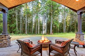 picture of grass area  - Large back yard with grass and covered patio with firepit - JPG