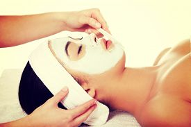 foto of face mask  - Relaxed woman with  a deep cleansing nourishing face mask applied to her face - JPG