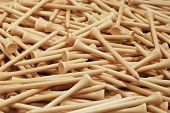 Close-up of natural colored, wooden golf tees.