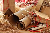 Christmas still life with eco friendly brown wrapping paper and gift packaging. Close-up with shallo