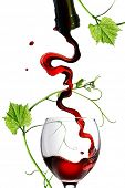image of red wine  - Pouring red wine in glass with rod isolated on white - JPG