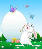 Illustration of an Easter Bunny painting Easter Eggs.