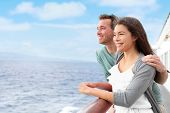 Romantic happy couple on cruise ship on boat travel embracing looking at view. Happy lovers travelin poster