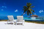 Two sun beds on beautiful beach at Maldives