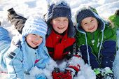 image of playmates  - Happy children in snow - JPG
