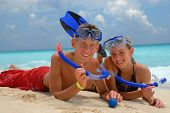 Happy snorkeling teens
