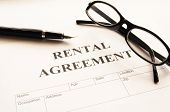 pic of rental agreement  - rental agreement form on desktop in business office showing real estate concept - JPG