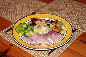 Cooked Gammon Sprouts Baked Onions And Fried Potatoes