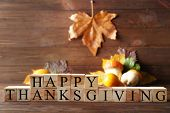 Wooden cubes with inscription HAPPY THANKSGIVING on blurred background. Thanksgiving day concept poster