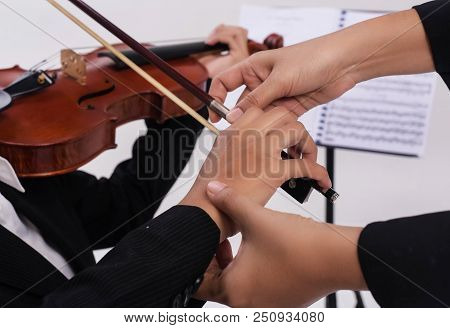The Violin Teacher Hands Is