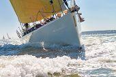 Close up of sailing boat, sail boat or yacht at sea with yellow sails poster