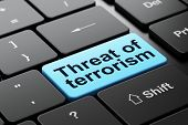 Politics Concept: Computer Keyboard With Word Threat Of Terrorism, Selected Focus On Enter Button Ba poster