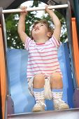 The child is playing on the playground.