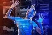 Interesting Device. Calm Curious Teenager Putting Two Hands On The Screen Of A Futuristic Transparen poster