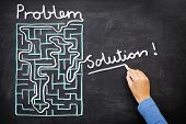 Problem and solution - person solving maze. Blackboard / chalkboard business concept.