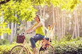 Happy Family. Smiling Mother And Son Riding Bike In The Park. Family Sport And Healthy Lifestyle poster