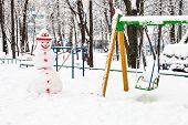 Snowman At Public Playground In Residential District Of Moscow City In Overcast Winter Day poster