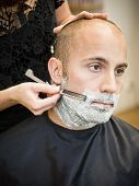 stock photo of electric trimmer  - Shaving situation at the hair salon close - JPG