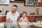 Little Kid Girl Help Man To Cook Lazy Dumplings In Light Kitchen At Table. Happy Family Dad, Child D poster