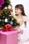 Little Smiling Girl Holding Christmas-tree Decoration