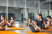 Fitness, Sport, Training, Gym And Lifestyle Concept - Group Of Young Woman Exercising In The Gym poster