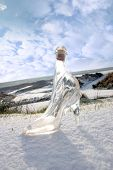 Crystal Glass High Heels On White Snowy Golf Course