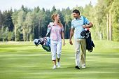 pic of caddy  - Young couple on the golf course - JPG