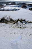 Crystal Glass High Heels Shoe On White Snowy Golf Course