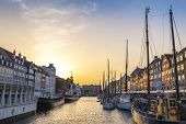 Copenhagen Sunset City Skyline At Nyhavn Harbour, Copenhagen Denmark poster