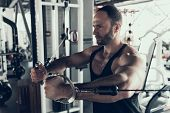 Bearded Young Man With Training Apparatus In Gym. Man With Athletic Body. Healthy Lifestyle And Spor poster