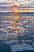 Постер, плакат: Sunrise Breaking Through Over The Ocean Ice Off The Coast Of Greenland Near Eqip Sermia Glacier On T