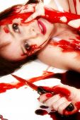 pic of serial killer  - Thirty something woman covered in blood on floor with knife - JPG