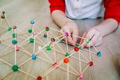 Child Making Geometric Shapes, Engineering And Stem Education poster